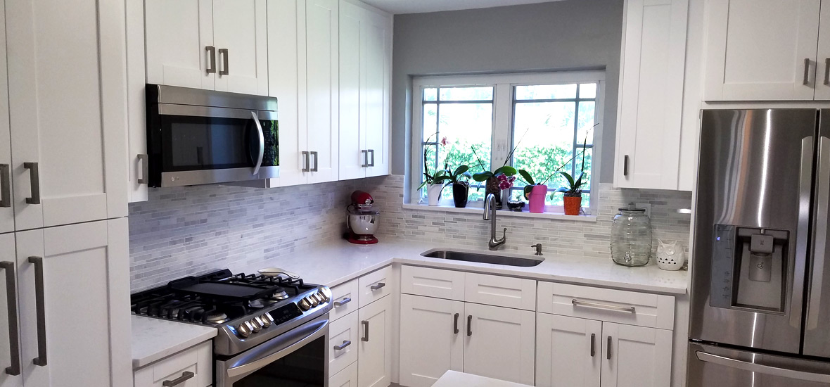Orlando white cabinets stone international kitchen for Kitchen remodels with white cabinets