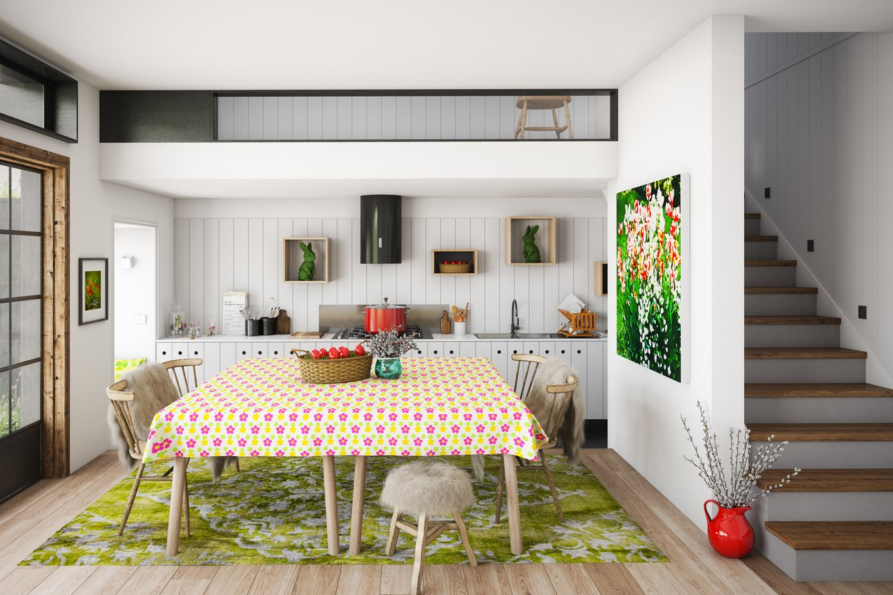 Digitally generated warm and cozy domestic kitchen and dining room interior with Easter decorations.