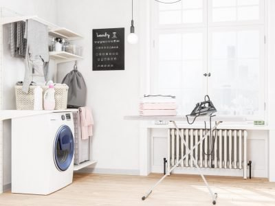Laundry room with washing machine and iron
